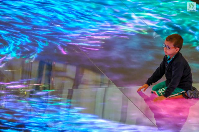 A kid playing around ArtScience museum.