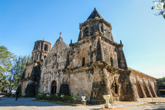 The uneven belfries on both sides of Miagao church.