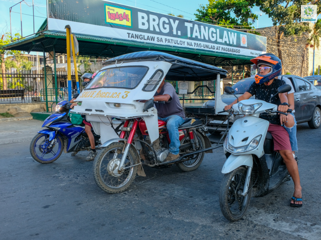 Tricycle (on the left) and motorbike (on the right) are two of most common mode of transport around Palawan.