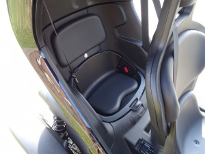 The passenger seat is built into the rear of the car and provides just enough space for an adult