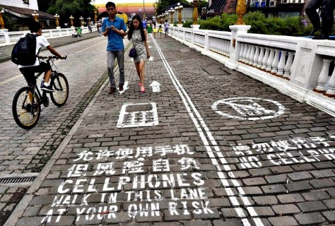 A designated 'Cellphone Sidewalk' in Chongqing, China. Photo credit: China Daily/Reuters