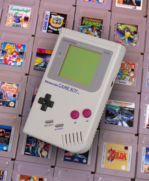 Nintendo Game Boy in front of Assorted Games Cartridges