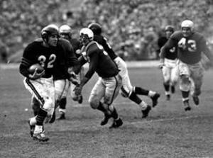 Johnny  Lujack on the run.