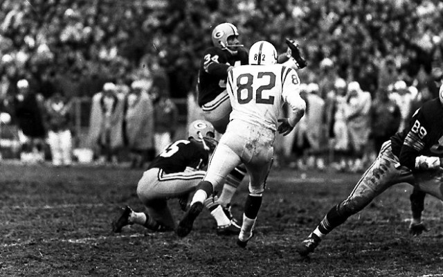 Packers - Packers - Bart Starr holds for Don Chandler in the Green Bay Packers vs. Baltimore Colts football game in 1965. Negative # 653794 PUBLISHED: 12-27-1965, Milwaukee Journal