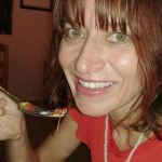 Julie eating a grasshopper in Oaxaca, Mexico