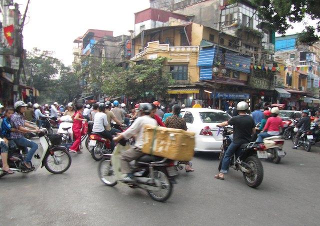 scary travel experiences - crossing the road in Hanoi, Vietnam - motorbikes