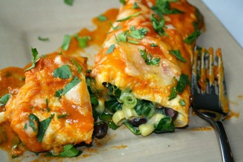 Black Bean Enchiladas on a plate with fork