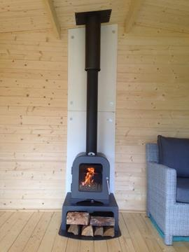 Stove installed in garden room / log cabin showing heat shield