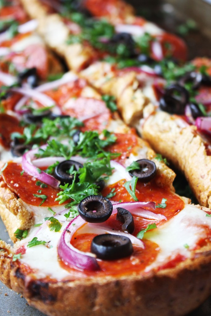"""Easy French Bread Pizza - this """"pizza"""" uses French bread as its base instead of crust to make for a super simple, quick, and absolutely delicious dinner!! TheGarlicDiaries.com"""
