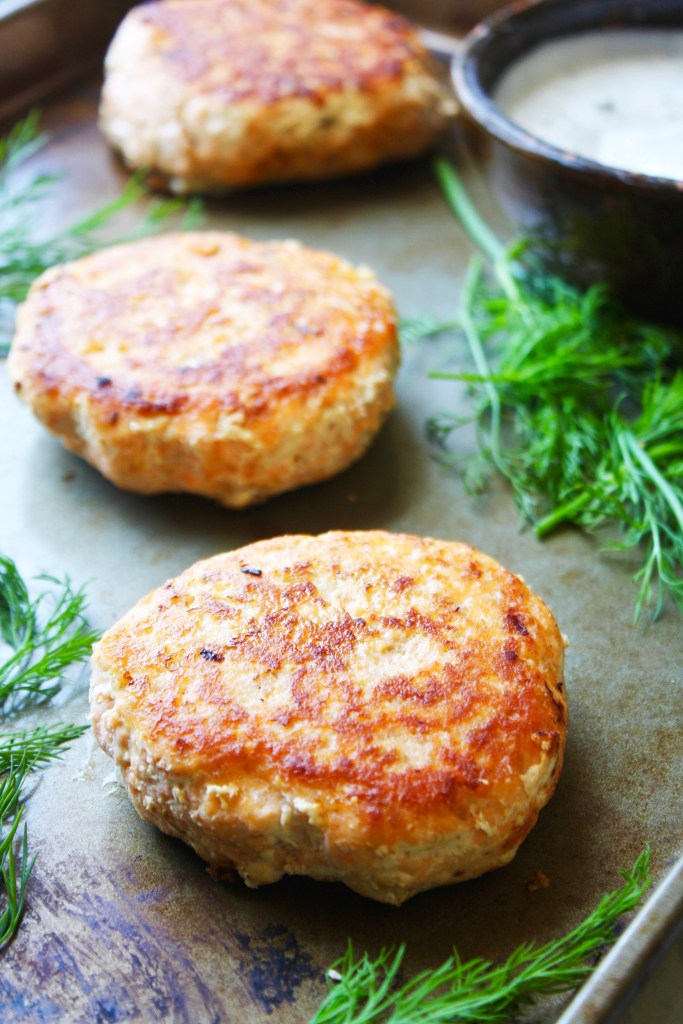 Salmon Burgers with Dill Caper Yogurt Sauce [21 Day Fix friendly] - These burgers are loaded with flavor, are easy to make, and are so good for you! They are a new favorite in my house. #21dayfix TheGarlicDiaries.com
