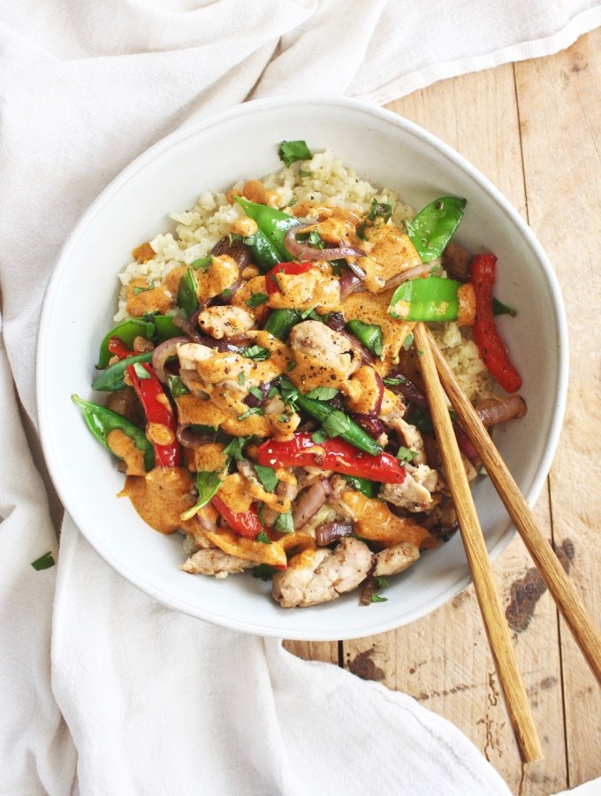 """Thai Stir Fry with Curry """"Peanut"""" Sauce - This delicious Thai stir fry is taken to a whole new level when it is smothered in a delicious curry """"peanut"""" sauce (we use almond butter instead to keep it whole30!). Serve it over cauliflower rice for a complete meal! TheGarlicDiaries.com"""