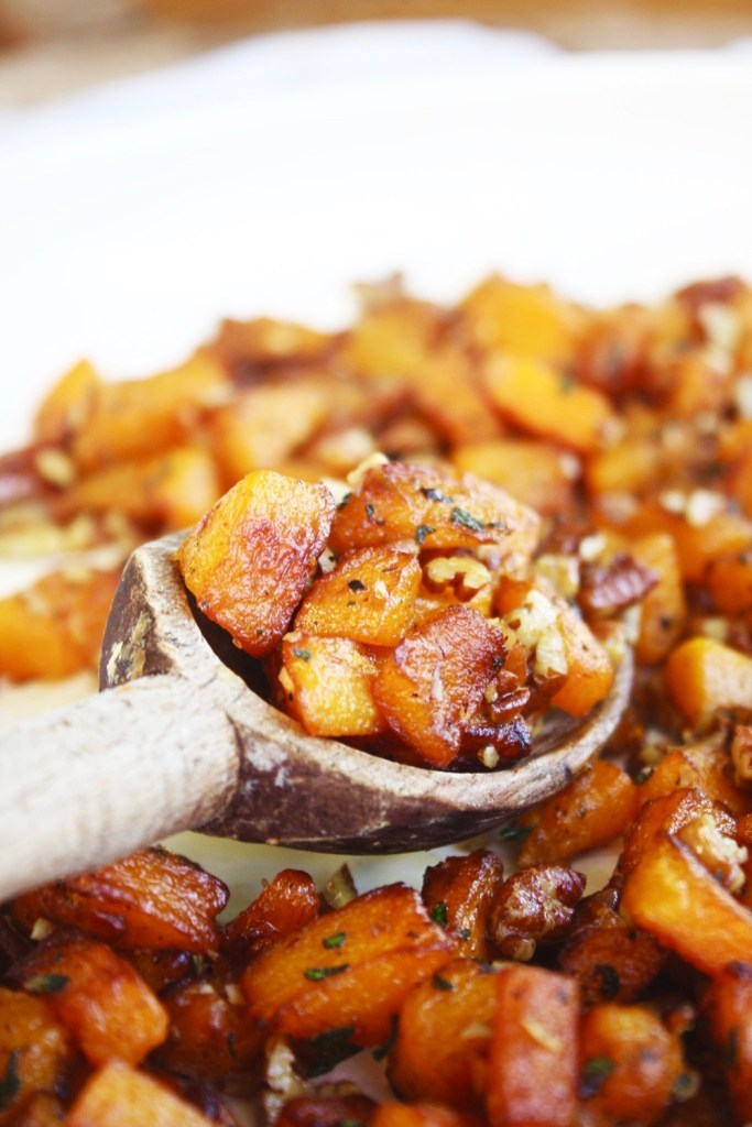 Caramelized Butternut Squash with Pecans - This cubed butternut squash is cooked until deeply golden brown and then pecans, garlic, and herbs are thrown in for the last few minutes until aromatic and flavorful! SO good - its the best butternut squash! TheGarlicDiaries.com