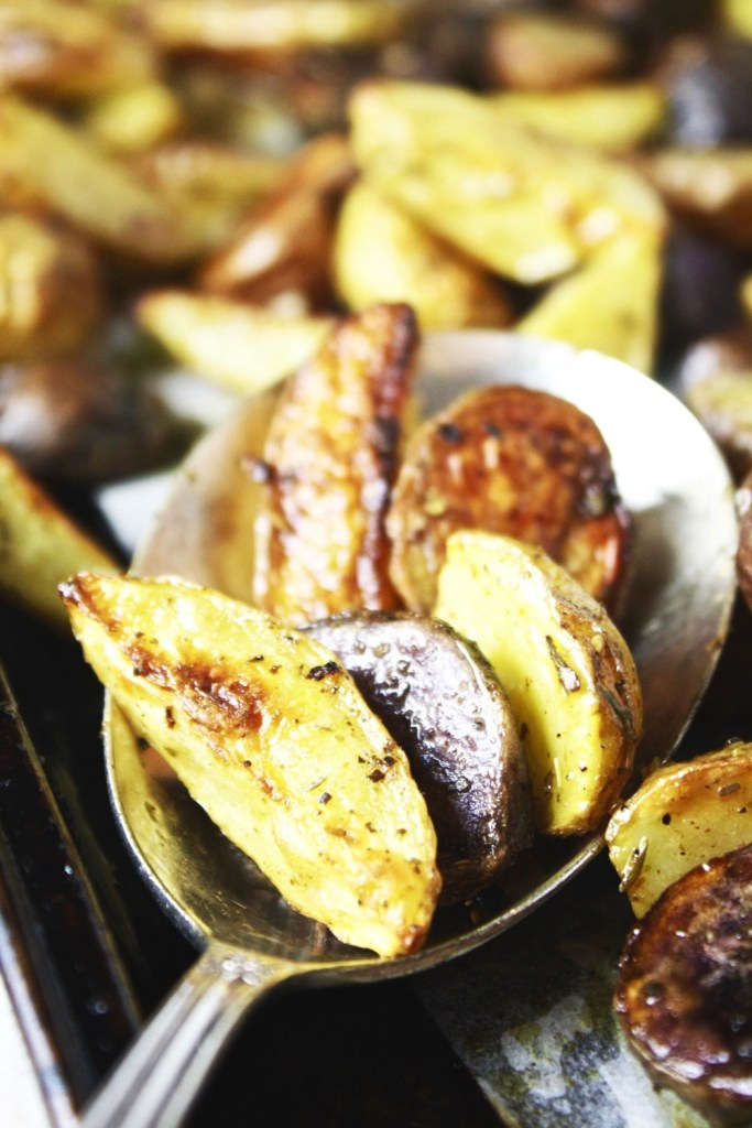 The BEST Italian Roasted Potatoes - These delicious, crispy potatoes are tossed in a delicious Italian sauce, roasted, and then tossed in more of the same sauce and served. They are insanely flavorful and crazy delicious! #Whole30 TheGarlicDiaries.com