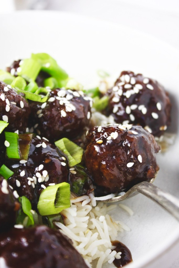 Mongolian Beef Meatballs - Just like the classic takeout dish, but in a fun new form: meatballs! Saucy, tender, and SO flavorful! Delicious served over rice! TheGarlicDiaries.com