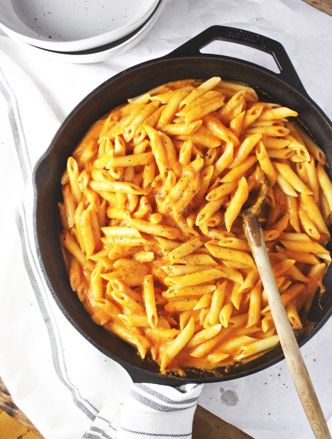 Dairy Free Vodka Sauce - This delicious, complex, slightly creamy sauce skips the dairy and uses cashew cream instead! It has the most delicious flavor and is perfect tossed with al dente penne! TheGarlicDiaries.com #vegan
