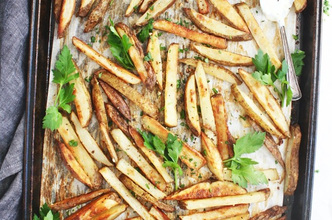 Oven Baked Fries with Lemon Garlic Dip - Skip the deep frier and make these healthier fries instead! They are addicting, so satisfying, and will become a new weekly fave! TheGarlicDiaries.com