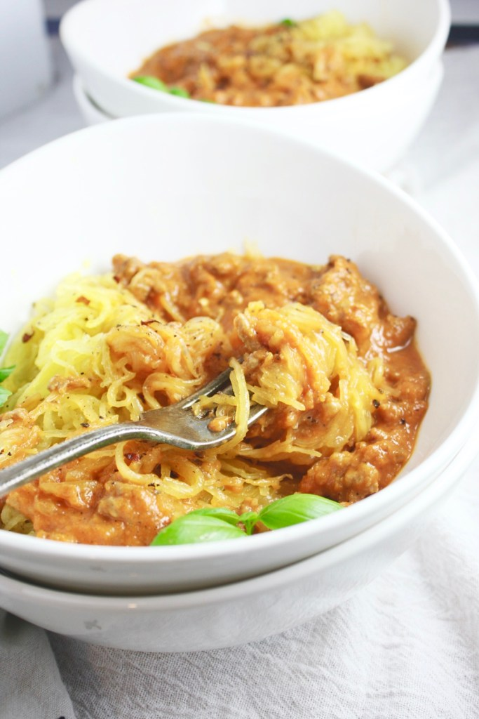 Roasted Spaghetti Squash with Meaty Vodka Sauce - The al dente spaghetti squash, the hearty, flavor-bomb (and also easy!) vodka sauce, the tender bites of sausage - it's a dream combo!