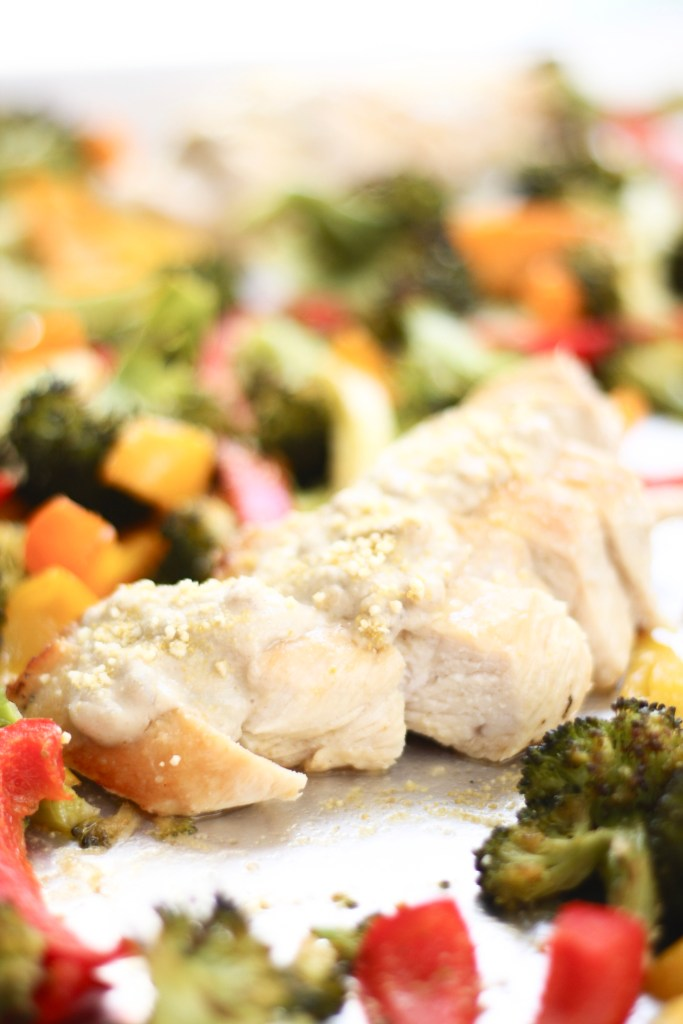 Sheet Pan Chicken and Veggies with Mustard Sauce - This easy dinner comes together in no time but feels fancy and luxurious with the smooth, creamy mustard sauce! A huge weeknight win. Dairy free, paleo, whole 30.