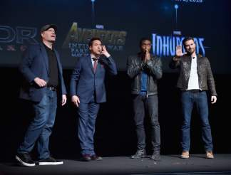 Kevin Feige with Robert Downey Jr., Chadwick Boseman and Chris Evans