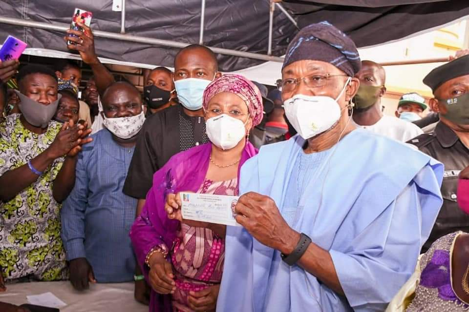 Aregbesola, Wife, Children Revalidate APC Membership; Assures On Commitment To Party's Success