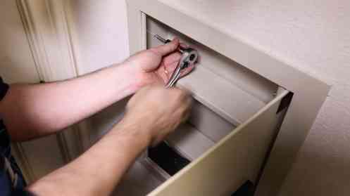 Install a Hidden Wall Safe 0010