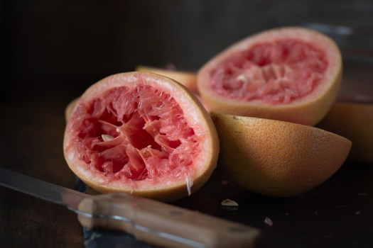 red grapefruits cut in half