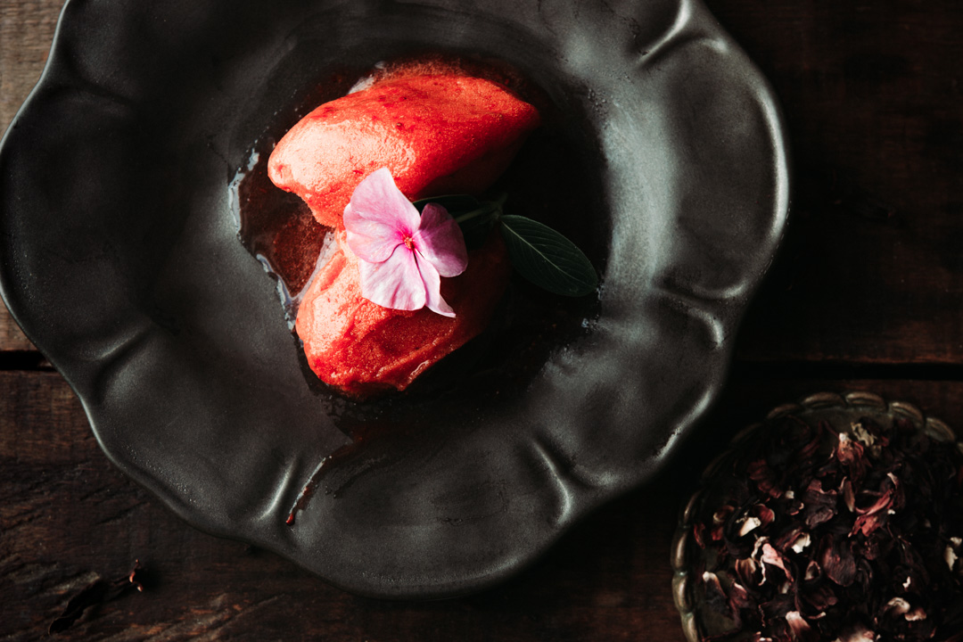 Two scoops of creamy strawberry hibiscus sorbet