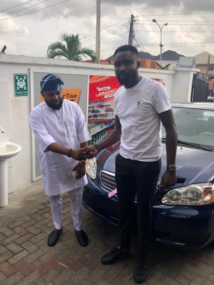 PHOTOS: #OldEnglish Boss, Akogun Lanre Alfred Rewards Staff With Car Gift