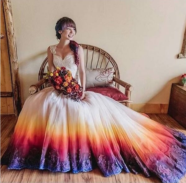 23cfa6d0cf41 The dress is the amazing handiwork of uber-talented artist (and bride)  Taylor Ann Linko, who embellished the hemline of her gown using a  beautifully ...