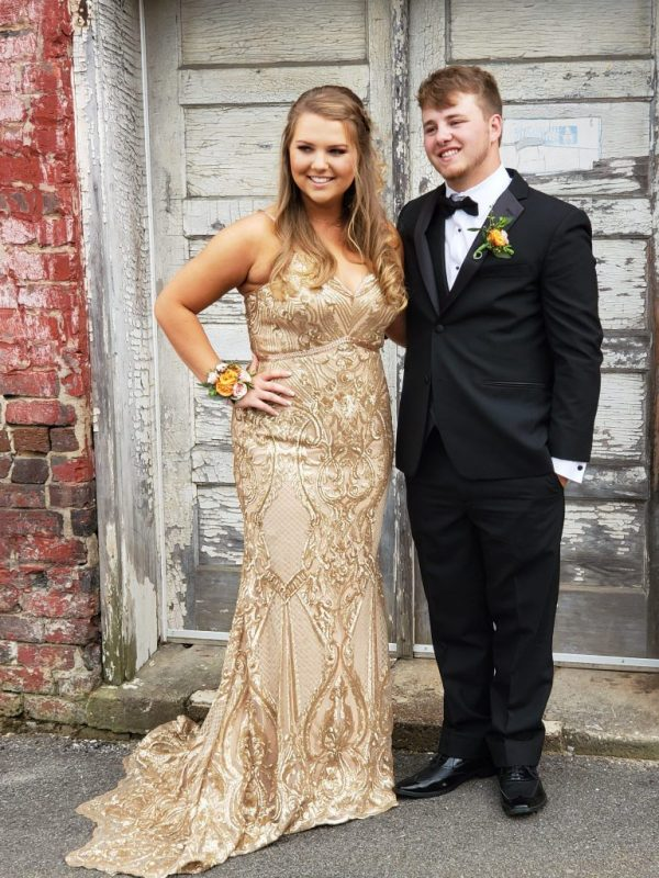 a47e6b1ab1c Stunning Taylor Irwin attended Anderson County High School Prom at Neyland  Stadium in Knoxville. We love her in this gorgeous embroidered gold gown.