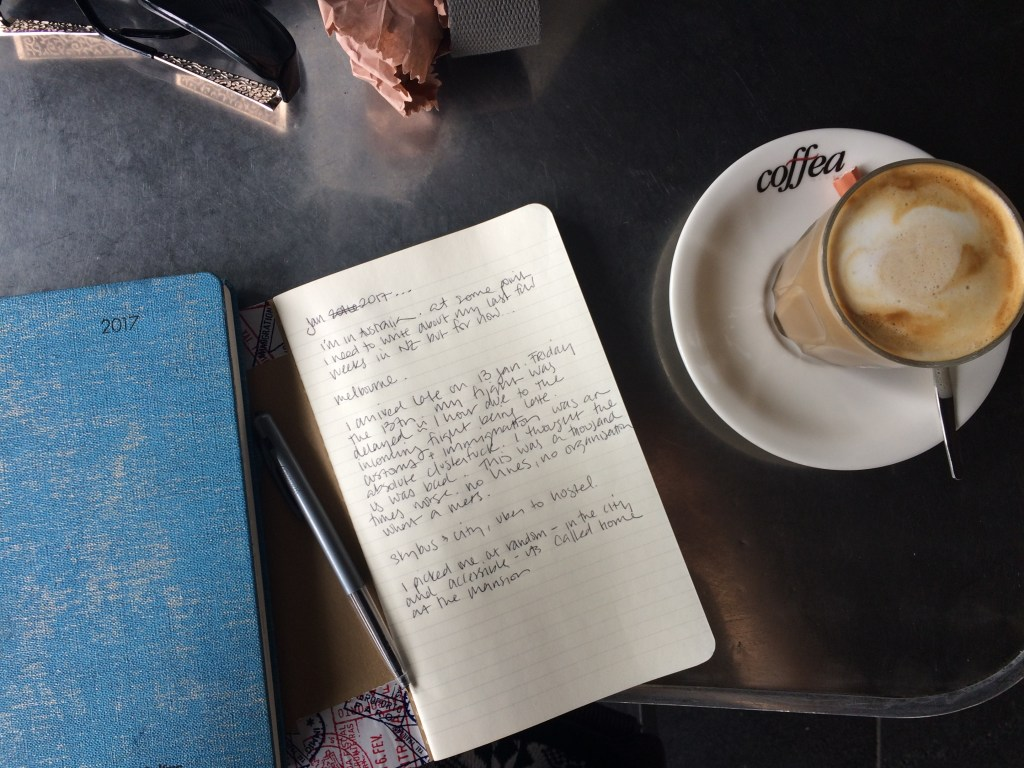 coffee and journal on table