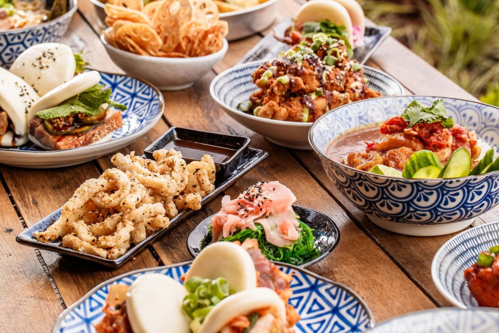 table array of Asian dishes