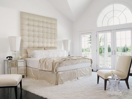 white bedroom. Create warmth with Flokati and sheepskin pillows rugs  Nothing feels better or more luxurious on bare feet And the use of silk satin adds a Glamorous White Bedrooms