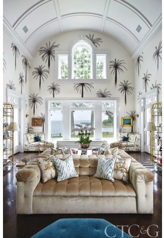 Hand Painted Palm Trees Enliven Walls In The Living Room With A Pair Of Sofas Quadrille Velvet Faux Bamboo Tagres Are From Bungalow 5