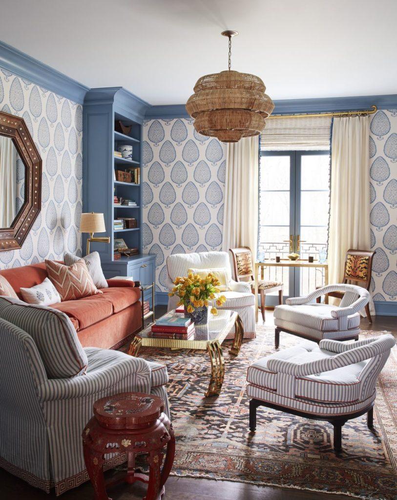 meg-braff-long-island-media-room-veranda-katie-ridder-wallpaper -blue-white-velvet-sofa-coral-brass-coffee-table