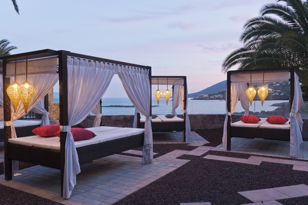 Sunbeds in the evening overlooking the ocean