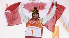 Gold medalist Mikael Kingsbury of Canada celebrates winning the freestyle skiing men's moguls final at the 2018 Winter Olympic Games