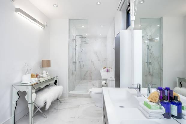 The master suite's bathroom features a walk-in shower with a built-in bench.