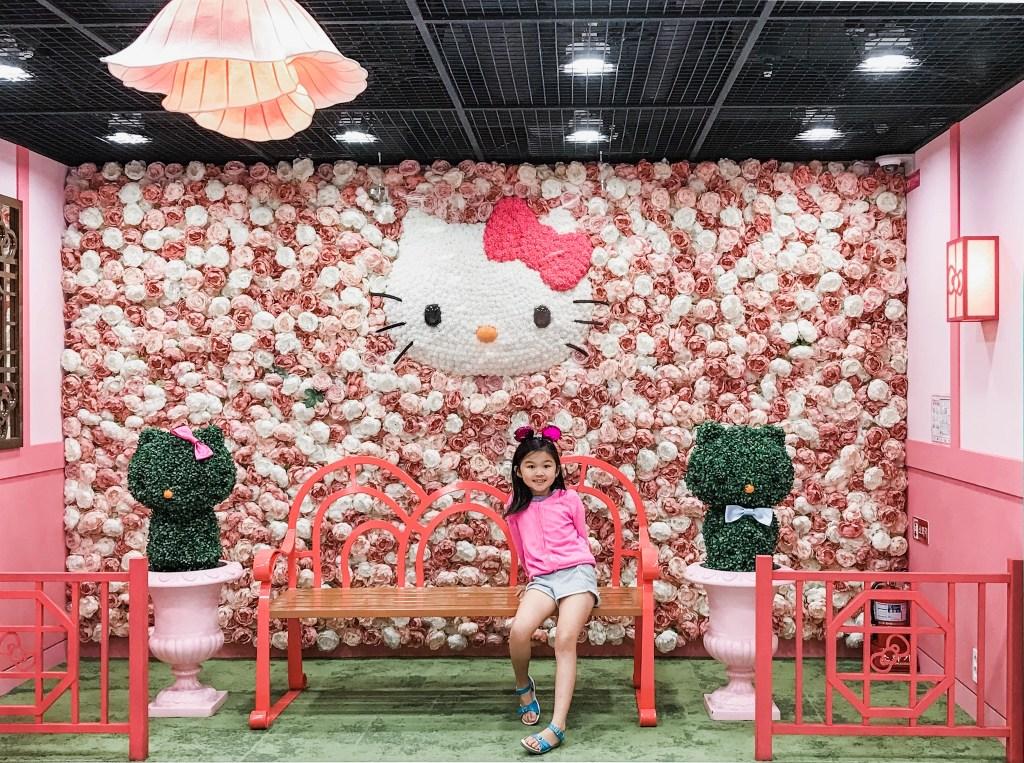 Girl sitting on bench at Hello Kitty Island - Seoul, Korea