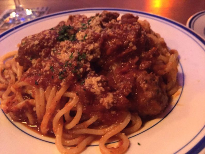 A small bowl of meatballs over the day's pasta, house-made spaghetti
