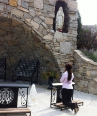 Imaculee Ilibagiza prays at Benedictine College's grotto.