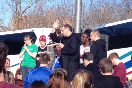Abbot James Albers, who as a student went on early trips to the March, blesses students. He will ride the bus with them.