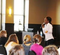 The Register featured a photo Immaculee Ilibagiza addressing Gregorian Fellows.