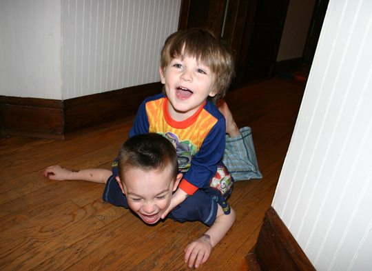 Big bros celebrated by riding each other around the house.