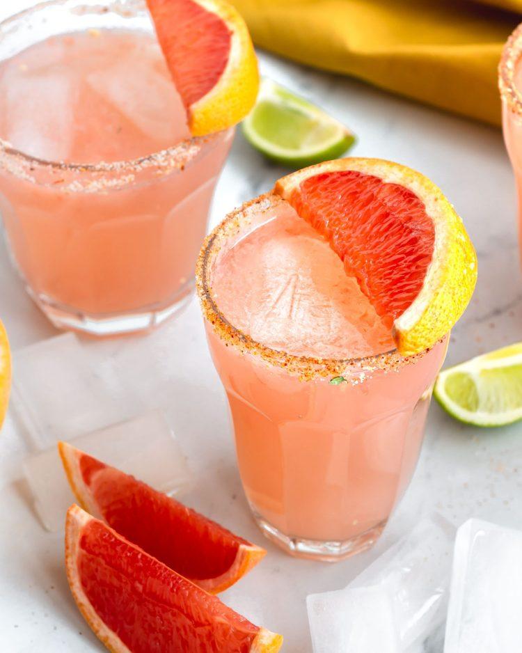 paloma drink with grapefruit slice as garnish.