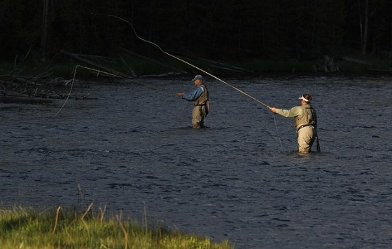 men fishing in a river