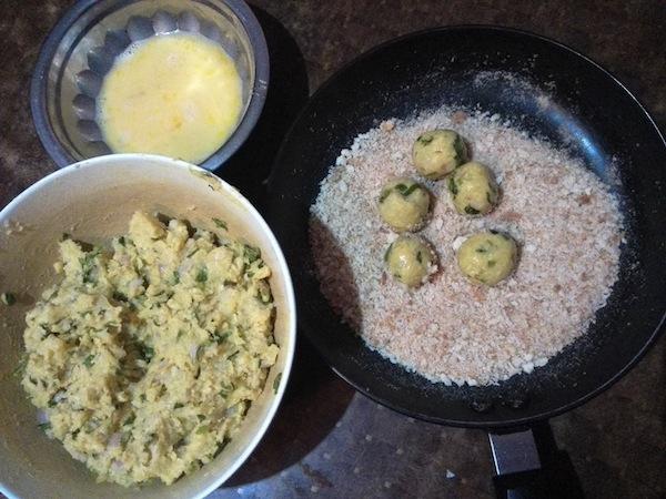 Potato cheese balls coated in beaten egg and breadcrumbs
