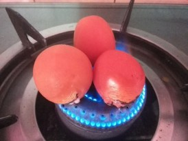 Roasting tomatoes directly over gas flame
