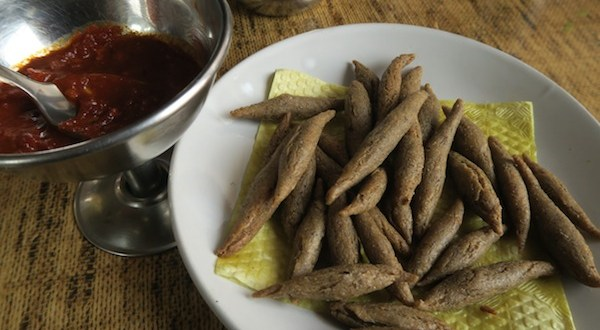 Kanchemba, a Thakali snack, is buckwheat fries fried in butter/ghee, and served with garlic-chilli sauce.