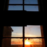 Sunrise through broken windows